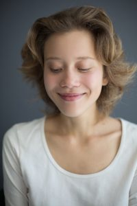 Portrait of smiling beautiful woman happily looking down